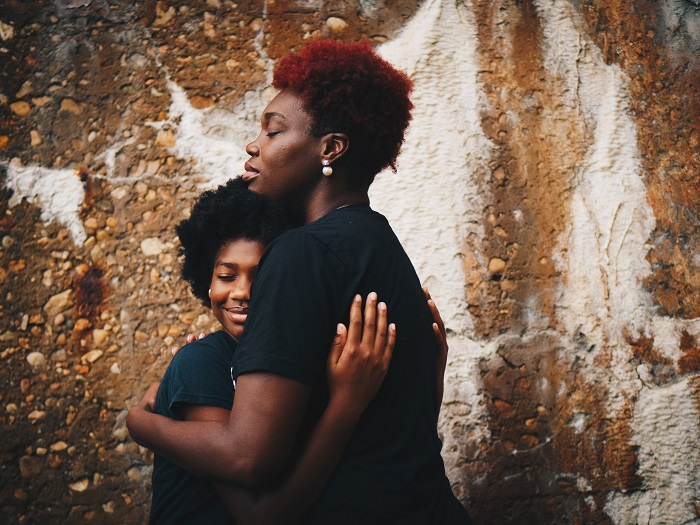 black woman hug